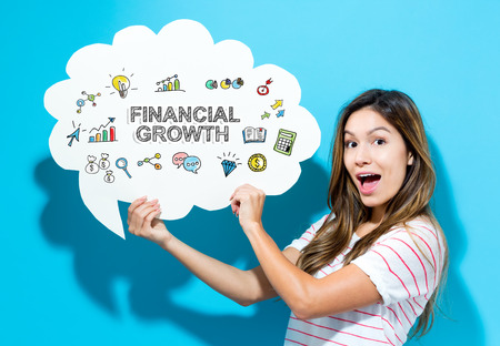 Financial Growth text with young woman holding a speech bubble on a blue background Imagens