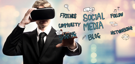 Social Media text with businessman using a virtual reality headset