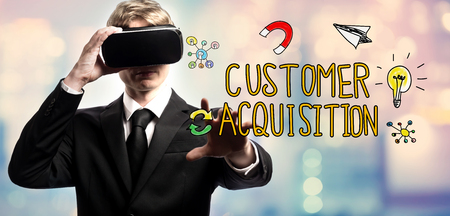 Customer Acquisition text with businessman using a virtual reality headset