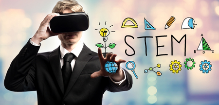 STEM text with businessman using a virtual reality headset
