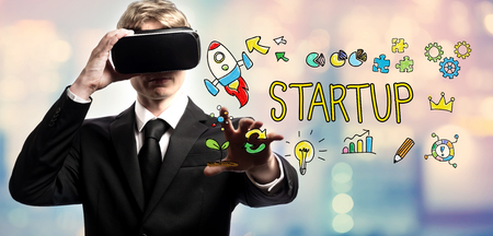 Startup text with businessman using a virtual reality headset