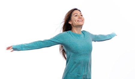 Happy woman with her arms outstreched isolated on white background