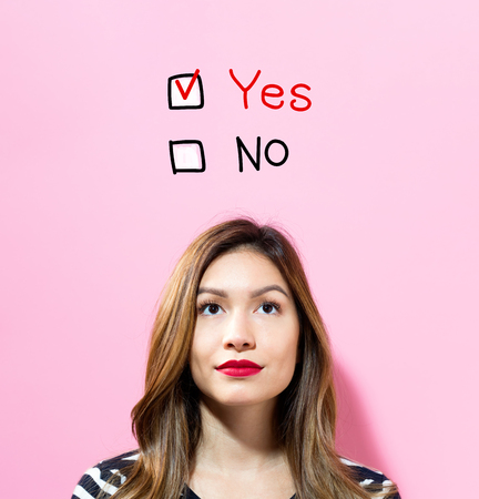 Yes No text with young woman on a pink background