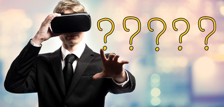 Question Mark text with businessman using a virtual reality headset