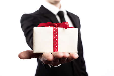 Businessman presenting a gift box on a white backround