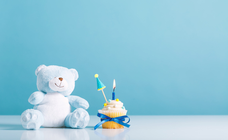 Child celebration theme with cupcakes and stuffed animals Stock Photo