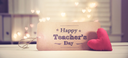 Teachers Day message with a red heart with heart shaped lights Archivio Fotografico