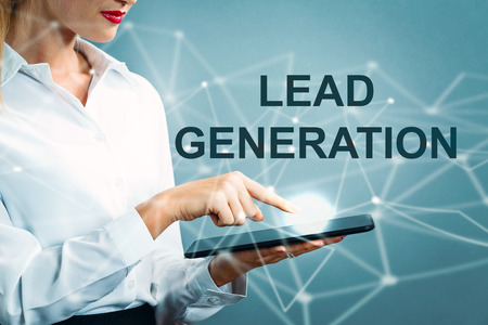 Lead Generation text with business woman using a tablet Reklamní fotografie