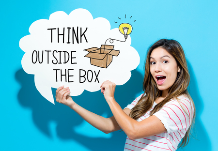 Think Outside The Box text with young woman holding a speech bubble on a blue background