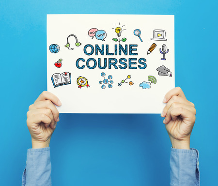 Online Courses text on a white poster on a blue background Stock Photo