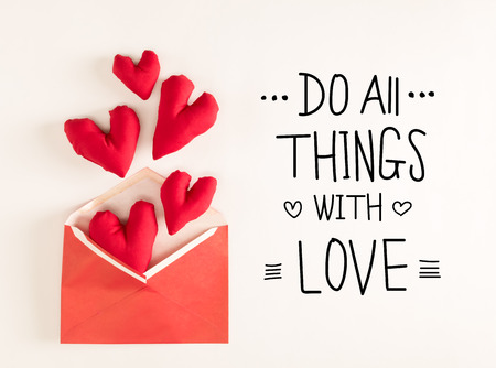 Do All Things With Love message with red heart cushions coming out of an envelope