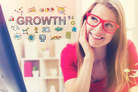 small business: Growth text with young woman in her home office
