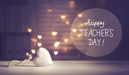 Happy Teachers Day message with a white heart with heart shaped lights