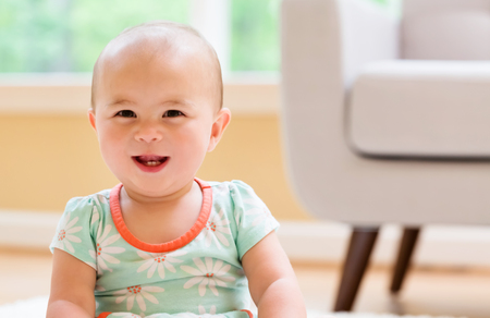 Happy Toddler girl with big smile in her house