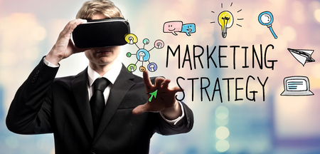 Marketing Strategy text with businessman using a virtual reality headset Reklamní fotografie
