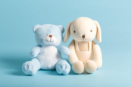 Babys stuffed animal toys on a blue background