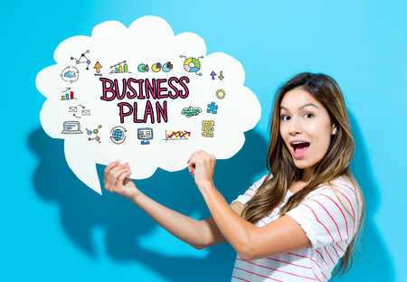 Business Plan text with young woman holding a speech bubble on a blue background