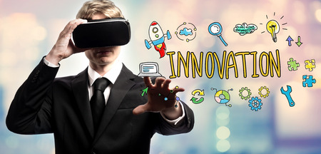 Innovation text with businessman using a virtual reality headset