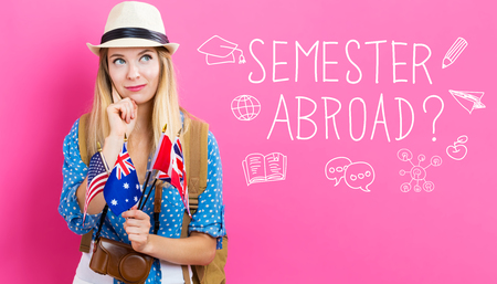 Semester Abroad text with young woman with flags of English speaking countries Stock Photo