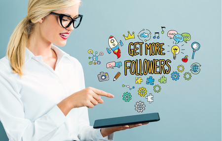 Get More Followers text with business woman using a tablet Stock Photo