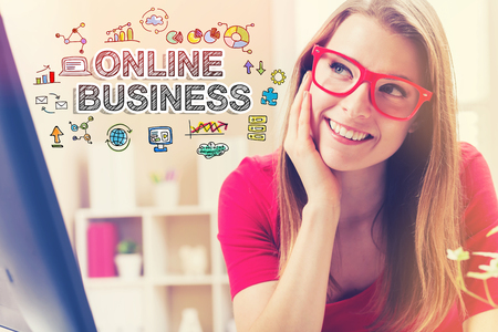 small business: Online Business text with young woman in her home office