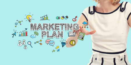Marketing Plan text with young woman on a blue background Reklamní fotografie