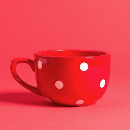 Big red coffee mug on a bright background