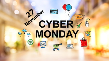 Cyber Monday text on blurred illuminated shopping mall background Stock Photo