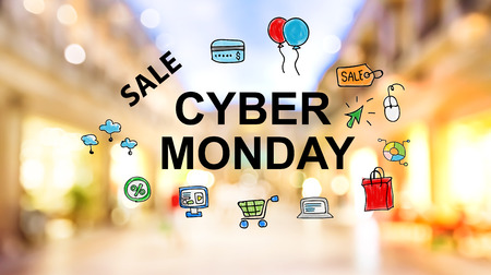Cyber Monday Sale text on blurred illuminated shopping mall background Stock Photo
