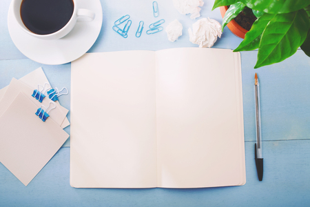 Overhead view of a open notebook on a desk Stock Photo