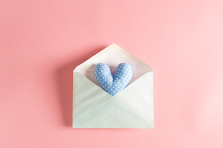 Heart shaped cushions coming out of a gift envelope - love and Valentines Day theme Banco de Imagens