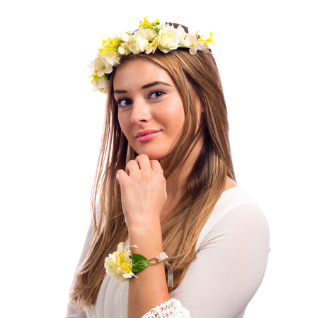 Beautiful young woman with a flower garland and a white dress isolated on a white background Stock fotó