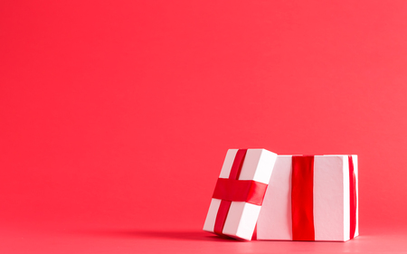Small present box on a red background Stock Photo