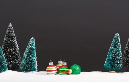 Christmas trees and little bauble decoration ornaments Stock Photo - 86568413