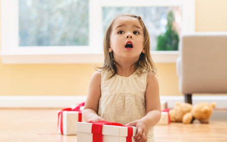 Little girl opening a Christmas present box