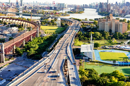 Aerial view of the Triborough and Hell Gate bridges on Randalls Island in New York City Stock Photo