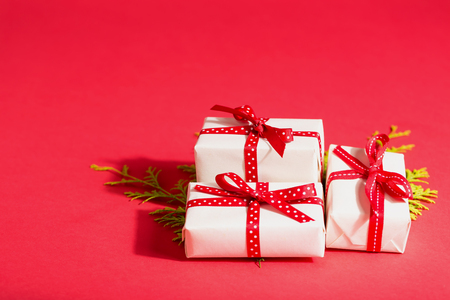 collection of christmas present boxes on a red background stock photo 87771174