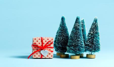 little handmade gift box with miniature christmas trees stock photo 87771178 - Miniature Christmas Tree