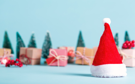 Santa hat and Christmas tree holiday theme
