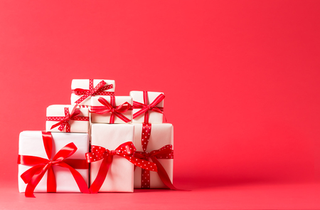 Collection of Christmas present boxes on a red background Stok Fotoğraf