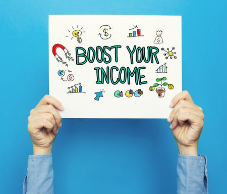 青の背景に白のポスターをあなたの所得本文を後押し 写真素材
