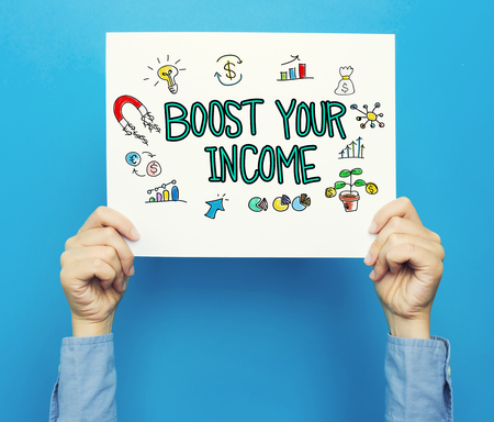 Boost Your Income text on a white poster on a blue background Stock Photo
