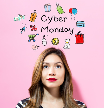 Cyber Monday text with young woman on a pink background Stock Photo