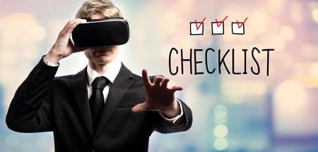 Checklist text with businessman using a virtual reality headset