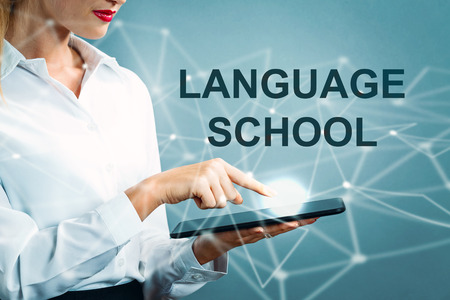 Language School text with business woman using a tablet