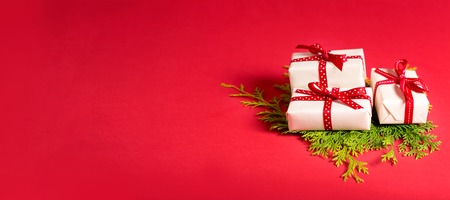 collection of christmas present boxes on a red background stock photo 89998954