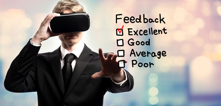 Feedback text with businessman using a virtual reality headset Stock Photo