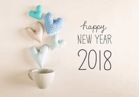 New Year 2018 message with blue heart cushions coming out of a coffee cup Stock Photo