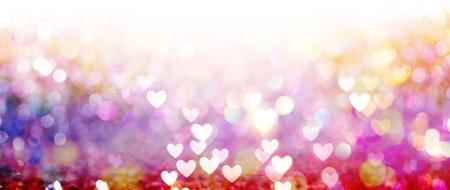 아름 다운 반짝이 마음과 추상 조명 배경