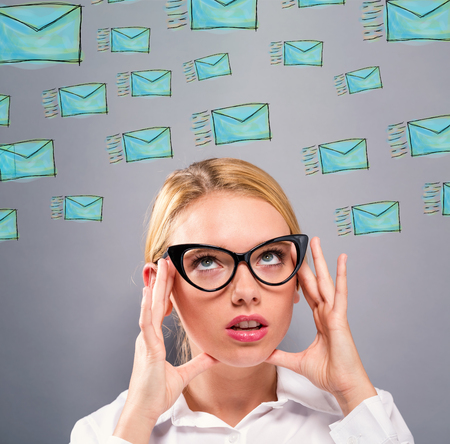 Emails with business woman on a gray background